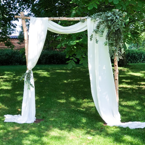 Backdrop berken + wit drapeer doek